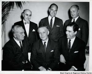 Congressman Arch A. Moore, Jr. with a group of fellow congressmen. Front, left to right: Congressman Charles A. Halleck, Congressman Arch A. Moore, Jr.; Governor Cecil Underwood. Back, left to right: Congressman Abraham Multer; unknown; unknown