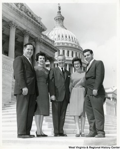 Congressman Arch A. Moore, Jr. with two unidentified men and two women on the steps of the Capitol.