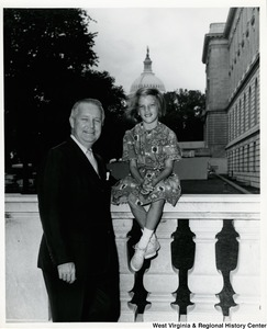 Congressman Arch A. Moore, Jr. with his daughter, Shelley. The Capitol Building can be seen in the background.