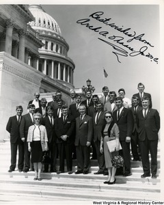 "Congressman Arch A. Moore, Jr. standing on the steps of the Capitol with a group of West Virginia Veterans of Foreign Wars.  The photograph is signed ""Best wishes from Arch A. Moore, Jr."""