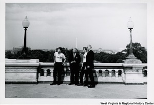 Congressman Arch A. Moore, Jr. with two members of the American Legion Boys Nation. Another unidentified man is with them. The Washington Monument is in the background.
