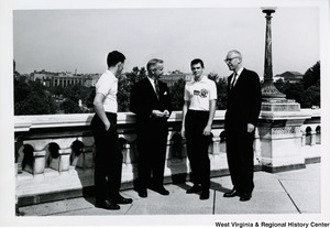 Congressman Arch A. Moore, Jr., with an unidentified man, talking to two unidentified members of the American Legion Boys Nation.