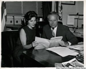 Congressman Arch A. Moore, Jr. showing an unidentified woman Congressional Record No. 118 for Friday, August 2, 1963.