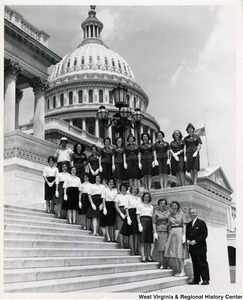 Congressman Arch A. Moore, Jr. standing on the steps of the Capitol with an unidentified group of women.
