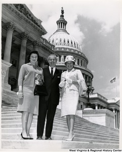 Congressman Arch A. Moore, Jr. standing on the steps of the Capitol with his wife, Shelley, and an unidentified woman.
