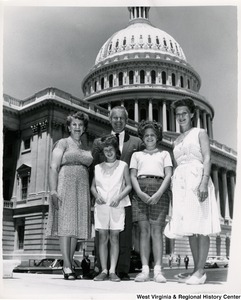 Congressman Arch A. Moore, Jr. standing in front of the Capitol with Miss Terry and Carol Hamm and two unidentified girls.