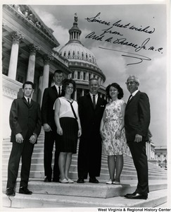 Congressman Arch A. Moore, Jr. standing on the steps of the Capitol with four 4-H members from Marshall County (W.V.).  These four members are participating in a two week training laboratory in Citizenship organized by the National 4-H Club Foundation, and the Federal Extension Service. Afterwords will use what they learned to draw up, and carry out a program of citizenship education during the coming year in their county, neighboring counties, and some on a statewide basis. The four members are: Karen Sue McCombs, Lois Garey, Robert Richmond, and Kenneth Jones.
