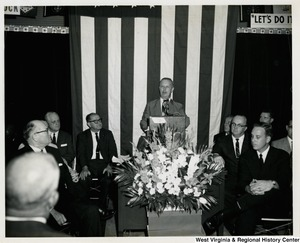 Congressman Arch A. Moore, Jr. speaking at a podium at a re-election campaign event.