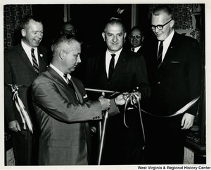 Congressman Arch A. Moore, Jr. cutting a ribbon at a re-election campaign event