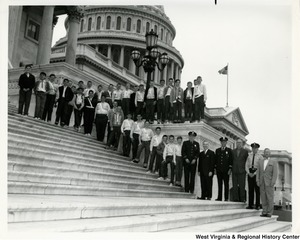 Congressman Arch A. Moore, Jr. standing on the steps of the Capitol with an unidentified group of children.