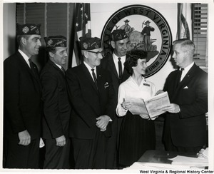 Congressman Arch A. Moore, Jr. showing a group of West Virginia Veterans of Foreign Wars The Congressional Record.