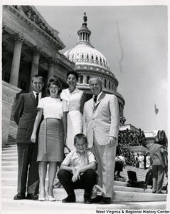 Congressman Arch A. Moore, Jr. standing on the steps of the Capitol with two unidentified women, an unidentified man, and child.