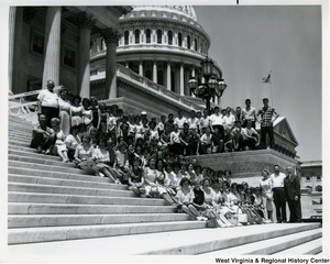 Congressman Arch A. Moore, Jr. standing on the steps of the Capitol with a large unidentified group of students.