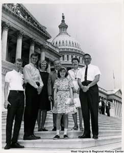 Congressman Arch A. Moore, Jr. standing on the steps of the Capitol with a small unidentified group, potentially a family.