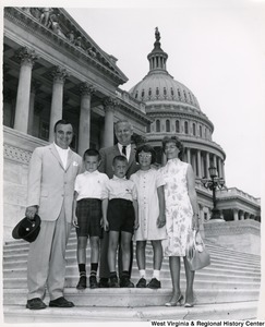 Congressman Arch A. Moore, Jr. on the steps of the Capitol with an unidentified family of five.