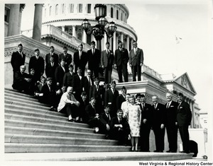 Congressman Arch A. Moore, Jr. and Congressman Harley O. Staggers standing on the steps of the Capitol with an unidentified group of veterans.
