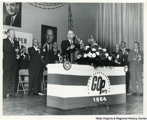 Congressman Arch A. Moore, Jr. speaking at a Republican Party (GOP) rally at the Gore Hotel Building, Clarksburg, W.V. Congressman Gerald Ford is standing behind and left of Moore.