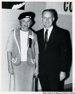 Congressman Arch A. Moore, Jr. standing with an unidentified woman during the GOP rally of 1964.