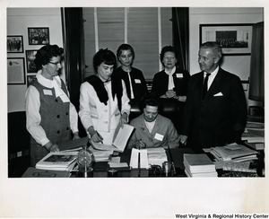 Congressman Arch A. Moore, Jr. with a group of DRIVE members in his office. Repeal of 14(b) was the subject of discussion when DRIVE ladies visited their legislators during a recent motorcade in Washington, D.C. Left to right: Jane Hall, Freda Martino, Martha Tucker,  Agnes Evans (seated), Vierdeen Landhom, and Congressman Arch A. Moore, Jr.
