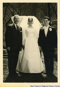 Congressman Arch A. Moore, Jr. standing with bride and groom, Jo Ann and Andy.