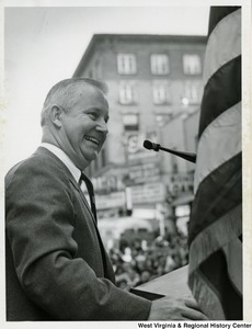 Congressman Arch A. Moore, Jr. speaking at a podium during a Barry Goldwater rally.
