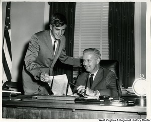 John R. Hoblitzell, son of the late John D. Hoblitzell, former U.S. Senator, gets a few tips from Congressman Arch A. Moore, Jr. in the congressman's Washington office. Hoblitzell spent several days as a summer intern in Moore's office prior to representing West Virginia at Boys' Nation.