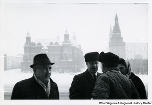 Congressman Arch A. Moore, Jr. and his wife, Shelley, talking to an unidentified man. They are near the Red Square in Moscow, Russia.