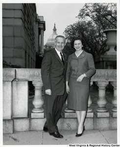 Congressman Arch A. Moore, Jr. standing beside his wife, Shelley. The Capitol dome can be seen in the background.