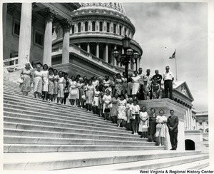 A large unidentified group, mostly women, on the steps of the Capitol. A staffer of Congressman Arch A. Moore, Jr. is in the photograph (bottom of the stairs).