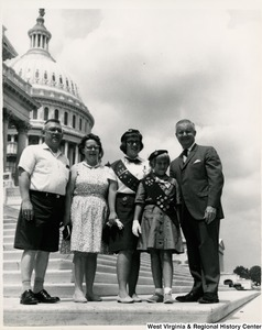 Congressman Arch A. Moore, Jr. on the steps of the Capitol with Thomas A. Cooper and his family. The girls are Girl Scouts in Troops 232 and 519.
