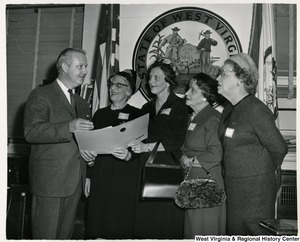 West Virginia Business and Professional Women meeting with Congressman Arch A. Moore, Jr. Left to right: Congressman Moore, Mabel Grimes of Morgantown, Mrs. Olive Rogers of Fairmont, Esther Brothers of Fairmont, and Kathryn Tucker Guth of Grafton.