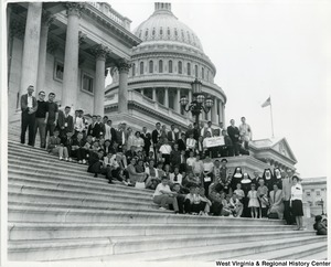 Members of Wheeling's School Boy patrol take time off from a tour of Washington, D.C. for a brief rest on the steps of the nation's Captiol and to greet First District Congressman Arch A. Moore, Jr. (bottom right).