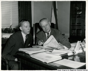 Congressman Arch A. Moore, Jr. showing the Congressional Record for the 89th Congress, 1st session, Wednesday, July 21, 1965, No. 132 to Edward Blundon.