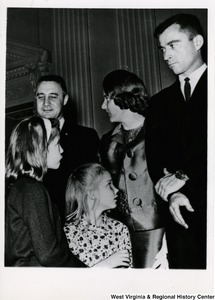Congressman Arch Moore's daughters Shelley and Lucy Moore with three unidentified people.