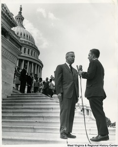 Congressman Arch A. Moore, Jr. being interviewed about the Immigration bill by ABC news commentator Irving (Chapmon?) on the steps of the Capitol building.