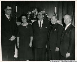 Congressman Arch A. Moore, Jr. (right) standing with four unidentified people (three men and one woman).