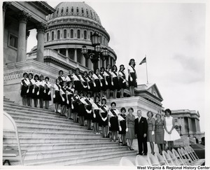 Congressman Arch A. Moore, Jr. standing on the steps of the Capitol with Girl Scout Troops 108 and 117.