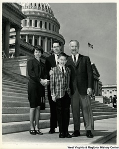 Congressman Arch A. Moore, Jr. standing on the steps of the Capitol with Mr. and Mrs. Milton Gutman and their son.