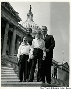 Congressman Arch A. Moore, Jr. standing on the steps of the Capitol with Mrs. Robert Q. Jones and her sons, Robert and Marsh.