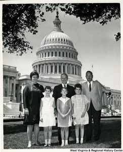 Congressman Arch A. Moore, Jr. with Mr. and Mrs. Gene Kersting and their three daughters in front of the Capitol building.
