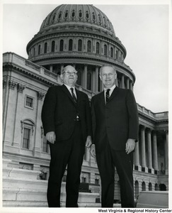 Congressman Arch A. Moore, Jr. standing in front of the Capitol with Charles Maxwell, Chairman of Harrison County, W.Va.