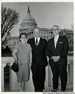 Congressman Arch A. Moore, Jr. (center) with Mr. and Mrs. Frank DeStafano. The Capitol building can be seen in the background.