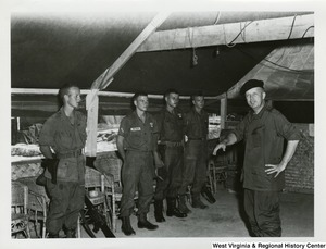 Congressman Arch A. Moore, Jr. speaking to four members of the U.S. Army in Vietnam.
