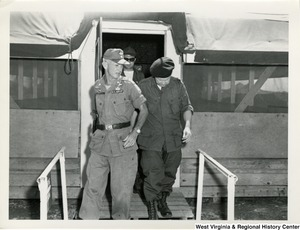 Brigadier General Ellis W. Williamson, Commander of the 173 Airborne Brigade, Congressman Arch A. Moore, Jr. and Mr. Garner J. Cline, Counsel Committee on the Judiciary, House of Representatives, leaving the 173rd briefing room for a fly over of War Zone D.