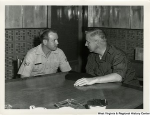 Congressman Arch A. Moore, Jr. talking to Staff Sergeant Arthur E. Sturgill at 2nd Air Division, Tan Son Nhut Air Base, Vietnam.