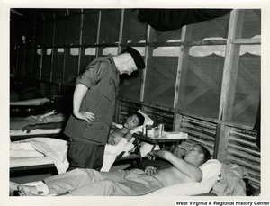 Congressman Arch A. Moore, Jr. speaking to wounded solders in Vietnam.