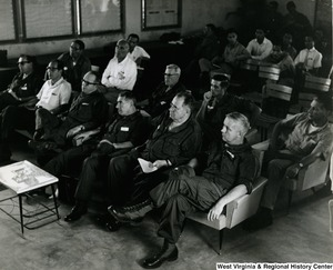 Congressman Arch A. Moore, Jr. listening to a briefing in Tuy Ha, Vietnam.