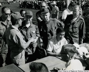 Congressman Arch A. Moore, Jr. at a piastre (French Indochinese currency) distribution in a refugee camp at Sng B, Vietnam.