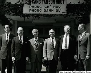 Congressman Arch A. Moore, Jr. standing with five unidentified men in front of the VIP lounge at Tan Son Nhut airport (now Tan Son Nhat International Airport).