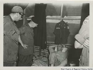 Congressman Arch A. Moore, Jr. and Mr. Garner J. Cline, Counsel Committee on the Judiciary, House of Representatives, talking to Chaplain (Captain) Hutchens wounded in action with the 173rd Airborne Brigade at the 3rd Mobile Army Surgical Hospital (MASH), Bien Hoa, Vietnam.